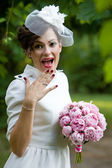 Wedding. Happy bride laughing, covering mouth with her hand. — Foto Stock