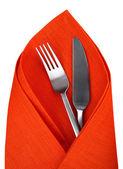 Orange napkin with knife and fork isolated. — Stock Photo