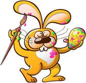 Easter rabbit decorating egg — Stock Vector