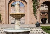 Fountain in a garden — Stock Photo