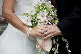 Holding bridal bouquet — Stock Photo