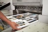 Sheet pulled from printing press — Stock Photo