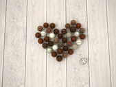 Chocolate Valentines sweet heart or Easter eggs heart on white wooden floor - top view — Stock Photo