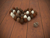 Chocolate Easter eggs heart on brown wooden floor also for Valentines day — Stock Photo