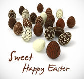 Chocolate Easter eggs on white background — Stock Photo