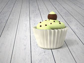 Gift Cupcake With Pistachio Cream And Chocolate Balls On Cold White Wood — Stock Photo