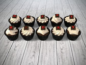 Gift cupcake with blank chalkboard signboard label on bright woo — Photo