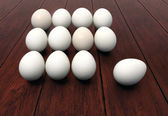 Dozen of eggs on wooden background — Stock Photo