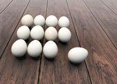 Dozen of eggs on wooden background — Stock Photo