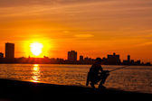 Havana fishermen at sunset — Stock Photo