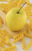Apple and rotini pasta — Stock Photo