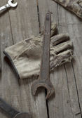 Rusty hand wrench tools and gloves — Stock Photo