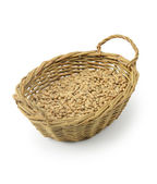 Wheat seeds in basket — Stock Photo