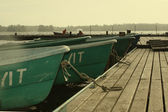 Two people in boat having moored to pier. — Stockfoto