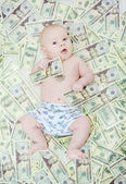 Child with dollars — Stock Photo