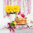 Dessert table with cake and flowers — Stock Photo