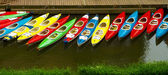 Colorful kayaks docked - as seen from above — Stockfoto
