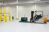 Forklift, bright spacious warehouse — Stock Photo