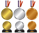 Three medals for the winners — Stock Vector