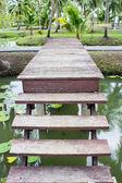 Wood bridge in garden — Stock Photo