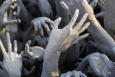 Hand from hell statue — Stock Photo