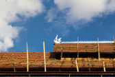 Thai temple roof under construction — Stock Photo
