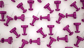 Many purple push pins — Stock Photo