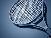 Tennis racket on blue  — Stock Photo
