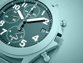 Sport watch rendered on blue — Stock Photo