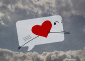 Funny love message in a way, the sky with clouds, heart — Stock Photo