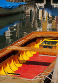 Colourful boat and reflections — Stock Photo