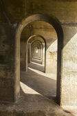 Concrete arches manmade structure, abstract pattern — Stock Photo