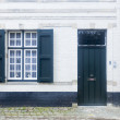 Traditional architecture housing and cobbled street Bruges, Bel — Stock Photo #45163761