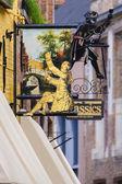 Signs outside antique shop Bruges — Stock Photo