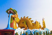 A Giant golden Chinese dragon with blue sky background — Stock Photo