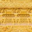 Thai traditional style stucco of golden temples walls — Stock Photo
