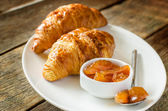 Apple jam and croissants — Stock Photo