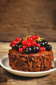 Chocolate cake mini with red and black currants — Stock Photo