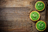 Tartlets with spinach cream for Halloween in the form of a monst — Stock Photo