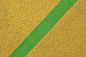 Yellow carpet with green line texture — Stock Photo