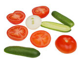 Tomatoes, cucumbers, onions, vegetables on a white background — Stock Photo