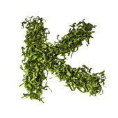 Salad letter K on white background — Stock Photo