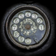 Old black telephone. Close-up of a rotary dial — Stock Photo #50305577