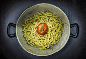 Colander with pasta and tomato  — Stock Photo