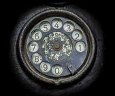 Old black telephone. Close-up of a rotary dial  — Foto de Stock