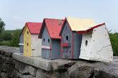 Bird Houses on Stone Wall — Stock Photo