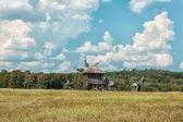 Old wooden windmills on the field. — Stock Photo