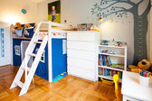 Boy room with house playground and tree with lost of toys — 图库照片