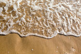 Soft wave of the sea on the sandy beach at summer — Stock Photo
