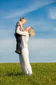 Beautiful boy and mom playing in spring park. Happy family concept. — Stock Photo